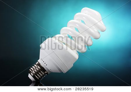 Energy saving lamp on blue background