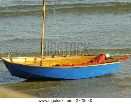 Small Blue Sailing Boat.