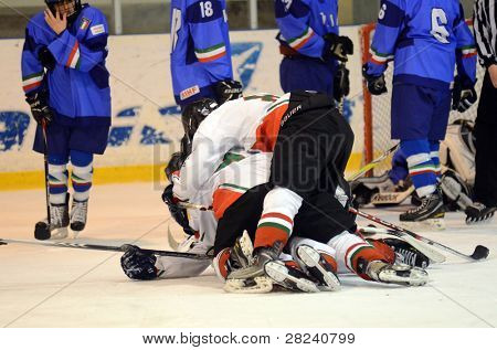KAPOSVAR, HUNGARY - DECEMBER 17: Hungarian players celebrate at a friendly ice hockey match with Hungarian (white) and Italian (blue) Under 16 National Team, December 17, 2011 in Kaposvar, Hungary.