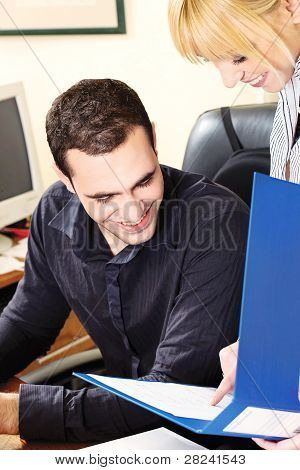 Manager With His Employer In Office Checking Document