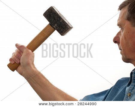 Senior Man Holding A Large Hammer