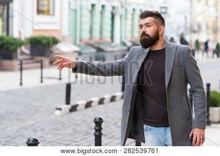 Businessman Catching Taxi While Standing