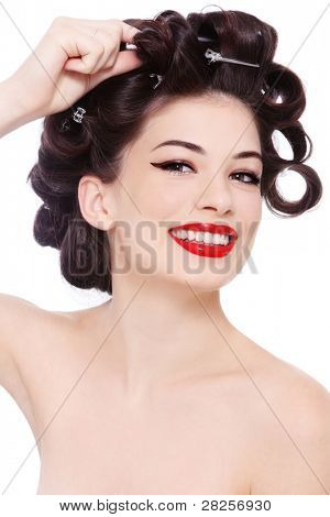 Young beautiful happy smiling girl with hair curles, over white background