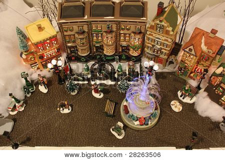 Christmas Village Decorating Scene showing great detail