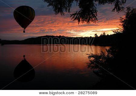 Hot-air Balloon Over Lake At Sunset Sunrise