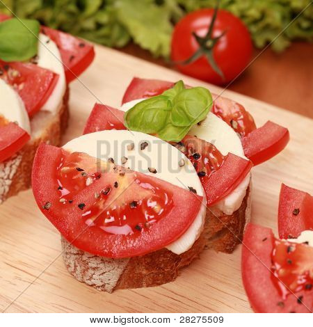 Fingerfood With Mozzarella Cheese And Tomatos