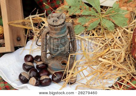Vintage kerosene lamp on autumn background