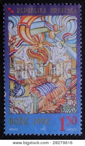 CROATIA - CIRCA 1997: A greeting Christmas stamp printed in the Croatia shows Christmas Creche, circa 1997