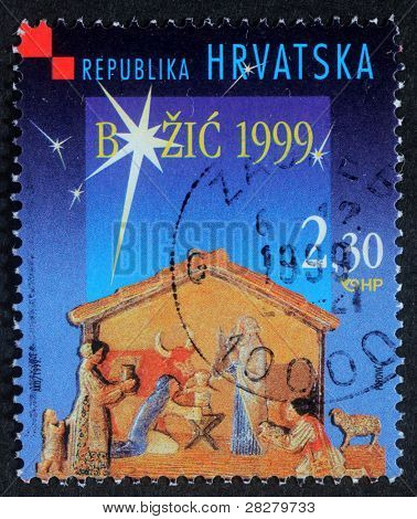 CROATIA - CIRCA 1999: A greeting Christmas stamp printed in the Croatia shows Christmas Creche, circa 1999