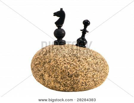 Isolated Stone With Two Chessmans