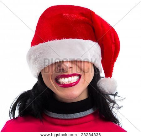 Closeup portrait of Pretty  smiling Santa girl wearing Christmas hat on her eyes , isolated over white background