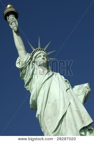 Statue of Liberty, Liberty Island closeup over blue sky.  New York City Manhattan