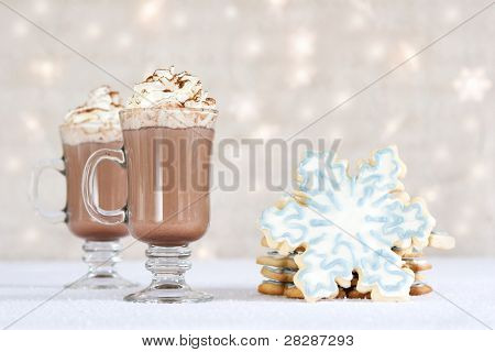 hot chocolate and cookies on winter background