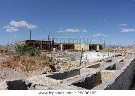 Abandoned apartment building and swimming pool. Salton City in the California desert.