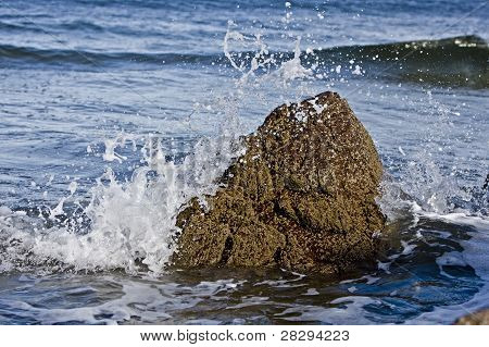 Small Rock In Waves