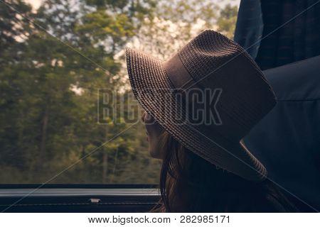 poster of Traveler Girl Watching Through Bus Window. Young Traveler Girl In Vacation. Girl Traveling By Bus. T