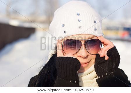 Winter Girl in a sunglasses