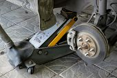 Wheel Arch Of The Car With The Removed Wheel. Brake Disc Car Wheels With Caliper At The Service Stat poster