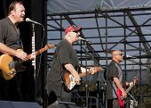CLARK, NJ - SEPT 18: Jim Babjak, Pat DiNizio, and Severo Jornacion of the band The Smithereens perfo