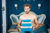 Sexy Surprise For Female. Man In Luxury Bedroom With Gift Box. Man Handsome Lover And Gift. Surprise poster