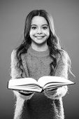 Girl Hold Book Read Story Over Orange Background. Child Enjoy Reading Book. Book Store Concept. Wond poster