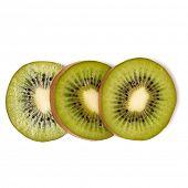 Three kiwi fruit slices isolated on white background closeup. Kiwifruit slices flatlay. Flat lay, to poster