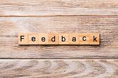 Feedback Word Written On Wood Block. Feedback Text On Wooden Table For Your Desing, Concept poster