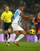 BARCELONA - JAN 16: Julio Baptista of Malaga goes after the ball during the match between FC Barcelo