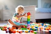 Child Playing With Colorful Toy Blocks. Kids Play. poster
