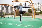 Cheerful Jogger Exercising Outside. Young Woman Doing Cardio Training On Outdoor Sports Ground. Card poster