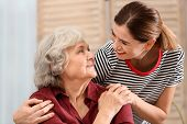 Elderly Woman With Female Caregiver At Home poster