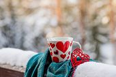 White Cup Of Coffee On A Snow Covered Balcony, Patio. Romantic Morning At The Resort In The Winter.c poster