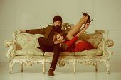Love And Romance. Couple In Love Relax On Sofa. Love Relations Of Fashionable Couple. Stylish Couple poster