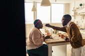 Nice Afro American Man Feeding His Beloved Wife poster