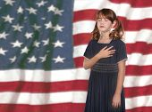 Patriotic Child Saying Pledge of Allegiance to the Flag