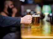 Friday Leisure Tradition. Beer Pub Concept. Weekend Lifestyle. Beer Mug On Bar Counter Defocused Bac poster
