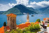 Wonderful scene of famous Kotor bay (Boka Kotorska) and St. Nikola Church. Location place Perast, Mo poster