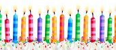 Brightly colored birthday cake candles against a white background poster