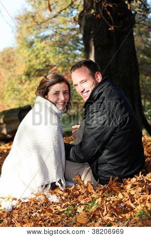 Smiling Couple Amongst Autumn Leaves