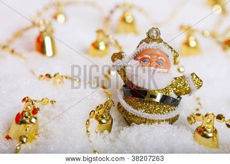 Santa Claus Figurine And Christmas Golden Bells
