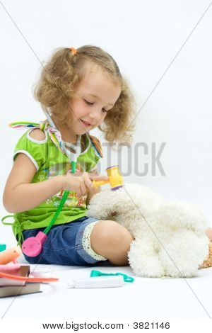 The Girl Plays Doctor With Toy Tools, Over White