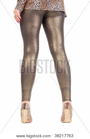 Sexy Stylish Legs In Shimmering Golden Leggins