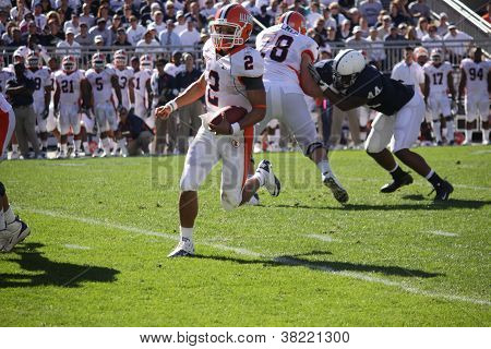 Illinois quarterback #2 Nathan Scheelhause runs for a long gain