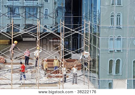 Reflections Of Scaffolding And Workers