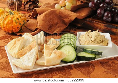 Hummus With Pita Bread And Cucumber