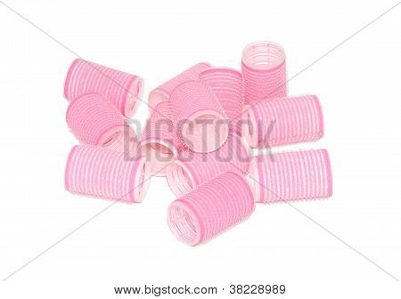 Twelve pink velcro rollers in a pile