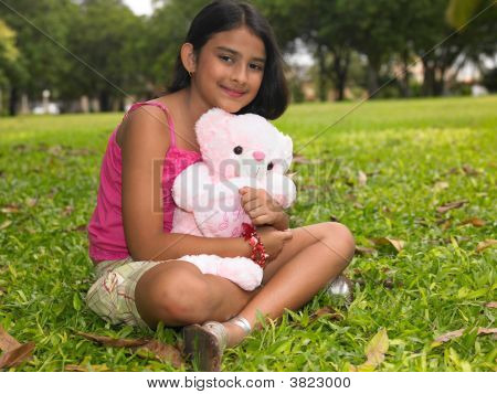 Asian Girl In The Garden With Her Pink Teddy Bear