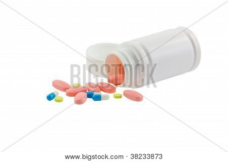 Tablets and pills isolated on white