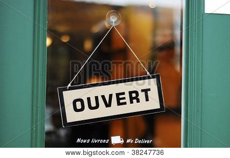 The Open sign in French concepts of business
