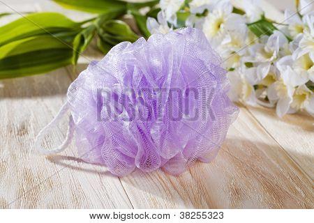 bath scrub and white flower